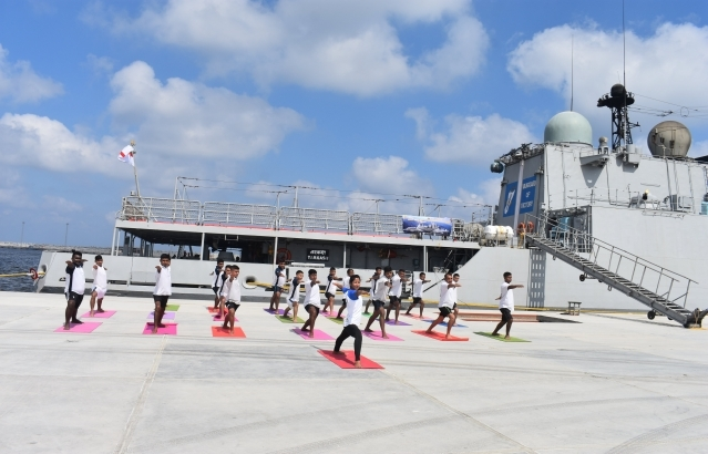Yoga practice on dock conducted by Yoga Instructor from MACIC